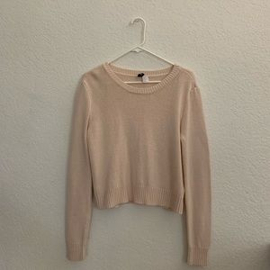 Pink cropped knit sweater